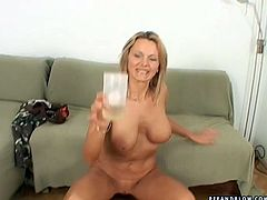 Fuckable blond mature with a slender body and a couple of big round tits hooks up with a horny dude. He forces her sit on the couch before he starts stroking her jugs and later finger fuck her soaking twat.