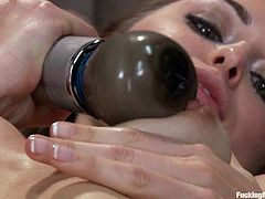 Skinny Riley Reid gets toyed by a machine in a gym