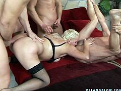 Ugly sweaty blondie in black stuff gets pounded by three men (MMMF)