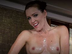 After showering, Sophie Moone rubs oil all over her body. Then, she plays with a blue vibrator, a clit vibrator and a fucking machine.