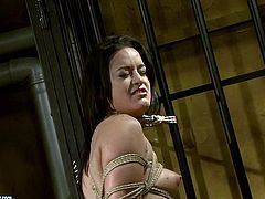 Don't pass by this hot 21 Sextury xxx clip. Kinky booty brunette with natural tits is fixed with ropes to the prison bars. Spoiled girl in black stuff slaps her ass with a lash and then rubs her pussy madly to cause orgasm.