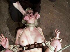 Blonde chick lies on the floor being tied up by the mistress. Then Cherry also gets her pussy tortured with ropes.
