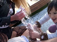 Two playful chics hook up with a horny dad outdoor. First they play snowballs before he lies with pants pulled down to welcome double blowjob from them in threesome sex video by Fame Digital.