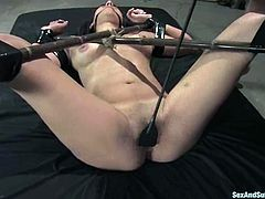 Honey gets tied on the metal cross and fucked hard