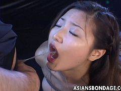 This Asian slut is tied up in rope in the sex dungeon of her master. He pulls out his pathetic dick and pisses straight into her open mouth. She swallows the pee and then they kiss. Her ropes are then tightened. Thi