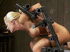 Busty blonde Holly Heart lets some man put her into irons. The dude attaches a metal stick to Holly's boobs and then destroys her pussy with a dildo.