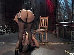 Bobbi Starr is going to spank this guy's butt in this femdom session packed with bondage and torturing action.