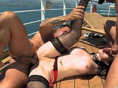 It was a birght sunny day with a warm wind, blowing! Sexy Angell Summers gets down on her knees and sucks two cocks. Double penetration is so hot!