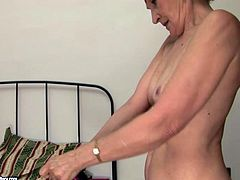 Spoiled grey-haired granny hooks up with a sizzling brunette slut. They kiss in lips with passion before young whore lies on her back to welcome a tongue fuck from aroused granny.