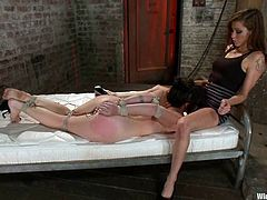 Natalie is having fun with Princess Donna Dolore indoors. Princess binds Natalie, attaches wires to her cunt and then smashes her pussy with a dildo.