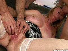 While one dude drills her twat from behind dirty-minded whore starts sucking the other meat stick greedily. This sex-starved blonde can also sucks two cocks at once that speaks to how good of a slut she is.