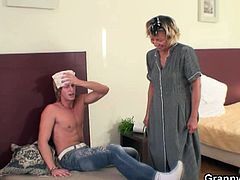 After a night of party, this young stud wakes up when the maid cleans his room. He's horny, so he hits on her and fucks her old cunt.