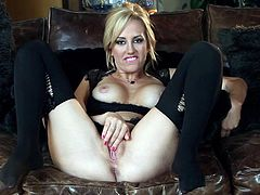 Allouring blonde in black stockings starts screaming while pushing a huge toy in