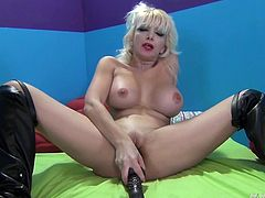 This hot milf loves to drill her juicy twat with some really impressive toys