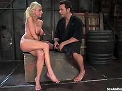 This slender blondie gets blindfolded and chained with a collar on her neck. This BDSM scene gives this babe a lot of pain!