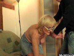 Pervert guy seduces old mom-in-law in this old-young scene. She's feels a bit awkward at first but then she grabs his cock and starts blowing. She opens her legs and he fucks her granny pussy!