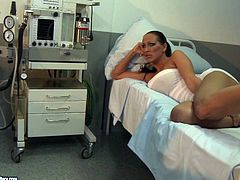 Spoiled black haired nurse in white dress fixes submissive booty brunette with ropes to the bunk bed. The hospital is filled with loud moans while spoiled dominant chick rubs tied up gal's pussy.
