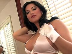 Busty pornstar loves stroking her huge glass toy up that wonderful cunt