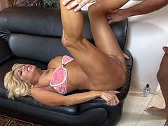Nice looking mature blonde Tara Holiday with long legs and big tits is his wifes sex obsessed mom. This hot experienced woman in barley there pink bra and high heels loves getting her neatly trimmed pussy banged hard again.