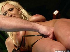 Salty blond mature gets tied to the chair by a rapacious master before he starts tickling her snatch with vibrator. Later she gives his sturdy cock a blowjob and tit fuck and finally ride him in cowgirl style in BDSM-involved sex video by 21 Sextury.