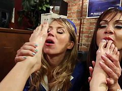 Three lesbian flight attendants get nasty and play with their feet during a layover. Two of the flight attendants take off their uniforms and show off their black lingerie. They suck on Lea's toes and rub their feet on her tits.