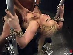 The busty blonde Candy Manson is getting a hardcore domination and bondage fuck where she's tied up and banged hard.