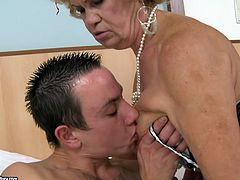 Cougar blonde bitch guzzles dick of one young handsome guy. Later she sits on his cock and rides it like sex insane old slut. Her hairy worn out pussy slides his fresh cock up and down.