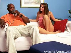 Frisky brunette hottie with a cute face stands on her knees in front of beefy black dude to give him a blowjob before he lies on his back to keep getting his cock oral stroked.
