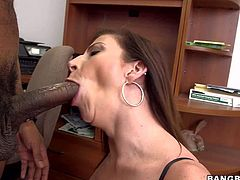 Sara Jay is a dick hungry big titted mature woman. She sucks black dick just like crazy at the office. She milks his dick on her knees and takes cumshot on her gigantic white boobs.