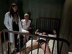Hot Francesca Le gets tied up by two female doctors, Bobbi Starr and Lorelei Lee. After that Francesca gets her ass and pussy toyed at the same time with strap-ons.
