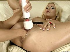 Sex-starved blondie stimulates her girlfriend's juicy pussy with vibrator to get it ready for hot fisting session. Check out this amazing sex video and I'm kinda sure you will like it.