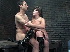 Brian Mayor is having fun with dominant hottie Penny Flame in a basement. Penny ties Brian up and pours hot wax on his belly and then fucks his butt deep and hard with a strapon.