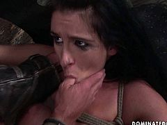 Hot blooded brunette MILF lies on the dirty floor bandaged with a gag in her mouth while a kinky dude pokes her shaved vagina in missionary style in sultry BDSM sex video by 21 Sextury.