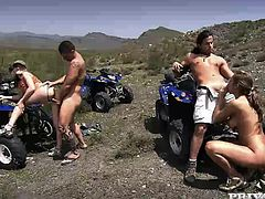 Two chicks ride bikes in the mountains with two guys. They make a stop to take a break. It turns to a wild sex. These chicks suck big dicks and get their asses destroyed.
