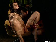Rapacious brunette domina ties a cuddly body of frisky red-haired MILF extremely tight, so her tits become blue. Later she takes a massive dildo to poke her shaved vagina in BDSM-involved sex video by 21 Sextury.