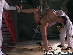 Holy shit this Asian chick that we have for you right here is so damn fine and here you will be seeing her in some serious domination where you will be seeing this fine looking chick dominated like mad.Her tender anus is filled up with water and she squirms and wriggles while the water spews out of her ass during kinky pussy teasing.