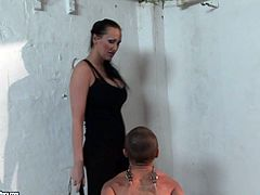 Horny brunette in black tight corset is a dominant one tonight. This busty and booty bitch ties up slim short haired girl with ropes and makes her kneel down to tease her pussy right away.