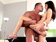 Brunette cocksucker wearing high heels gets butt fucked