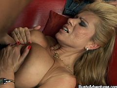 Huge tittied blonde woman toys the pussy and licks her boobs. Later on she gives a blowjob expertly and gets fucked rough on a sofa.