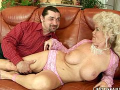 Bosomy blond mature in lacy pink lingerie gets her big firm tits oral stroked by rapacious young lover before he clings to her bearded vagina to give a tongue fuck.