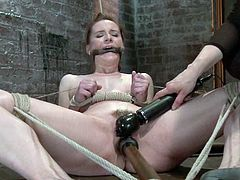 Sexy girl gets tied up and gagged. Later on she also gets her pussy toyed with a vibrator and a dildo at the same time.