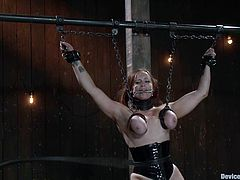 Bella Rossi gets multiple orgasms while being tormented in a cellar