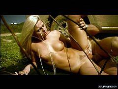 Adorable blonde obbi Eden is getting naughty with some guy in the field. They have oral sex in 69 pose and then the guy smashes Bobbi's cocohie from behind.