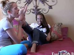 Pink toes sucked by two foot fetish brats