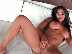 Smoking hot tanned black haired bombshell Jenaveve Jolie with arousing heavy make up and jaw dropping firm hooters in high heels only stretches pink honey pot in close up.