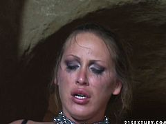 Provocative whore wearing black tight corset and nylon stockings is getting brutally mouth fucked in the beginning of the fuck scene. Then she gets fingered in her hairy clam. Later she rides hard shaft like crazy.