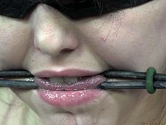 Pretty Tegan is being tortured and humiliated just the way she likes it. The cutie gets her breasts squeezed really hard and then her mouth gag is removed only to be chocked with a big black cock. She can't do nothing about it and obeys as the chocolate cock goes deeper down her throat!