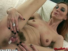 Watch this nasty and skinny redhead milf gagging herself on a thcik rod of meat. Then watch her as she gets her hairy cunt drille