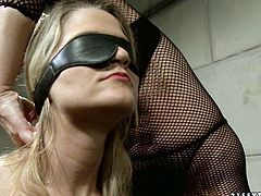 Flat breasted blond fairy gets suspended with her mouth plugged by a rapacious domina before she folds her eyes and starts pinching her naked body with clothing pegs in BDSM-involved sex video by 21 Sextury.