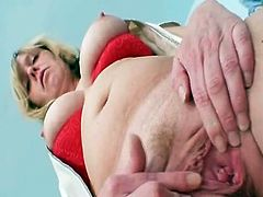 Busty blonde Mature woman working as head Nurse inside gyno clinic likes sitting onto gynochair and spreaDing beaver about gyno tools
